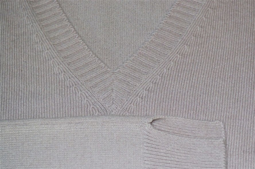 close-up of muave-colored cashmere sweater