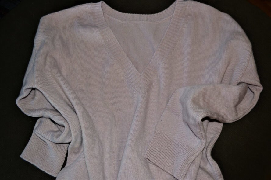 muave-colored v-neck sweater