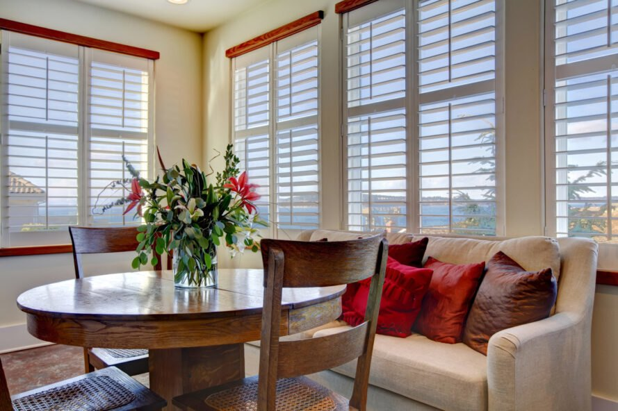 living room with blinds on the windows