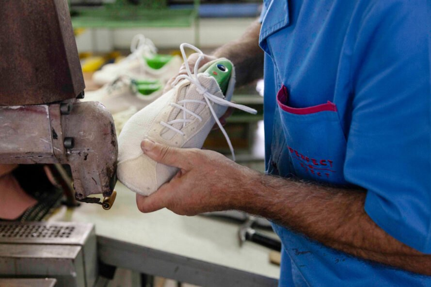 person sanding sides of a shoe