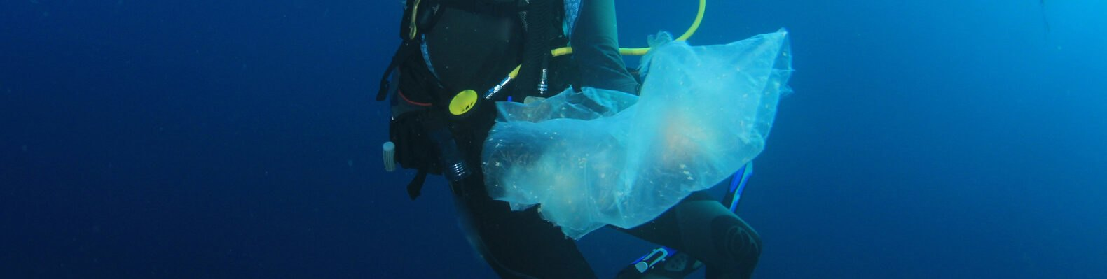 Scuba diver cleans up plastic pollution discarded in ocean