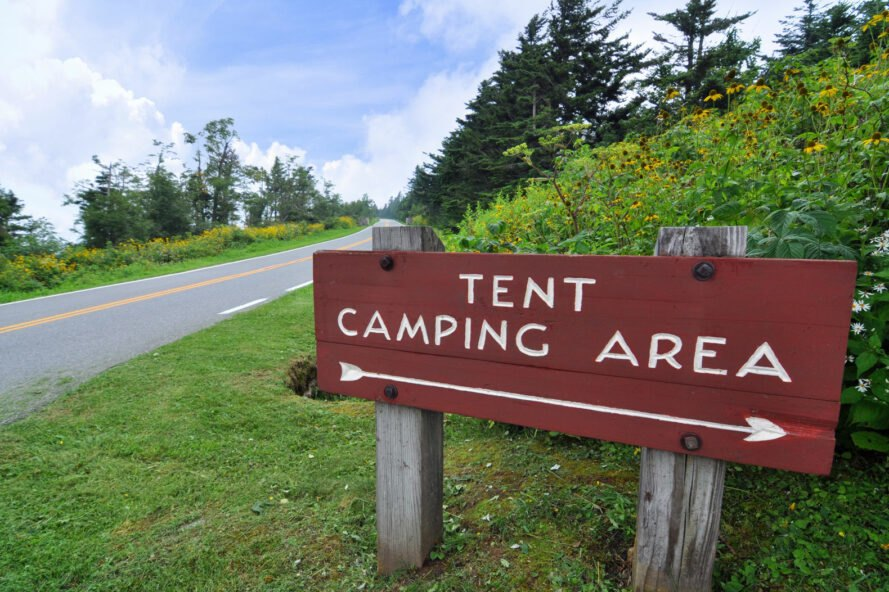 tent camping area sign near camping site