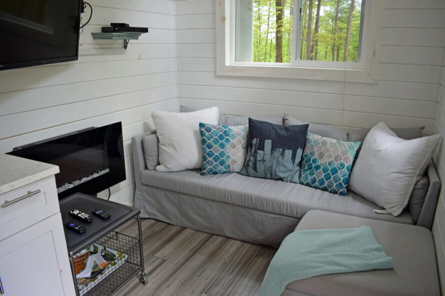 tiny home interior with gray sofa