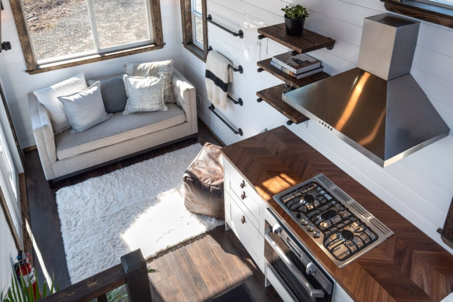 aerial view of tiny home with sofa and large brown poof seat