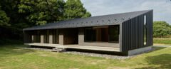 black timber home with mono-pitched roof