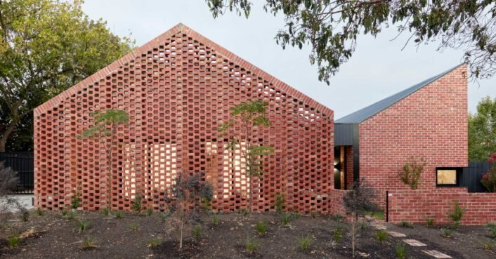 Two sustainable rental units dressed in reclaimed brick are