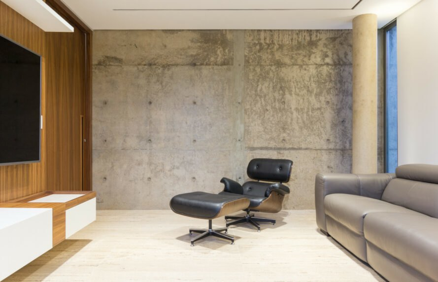 minimalistic living space with concrete walls