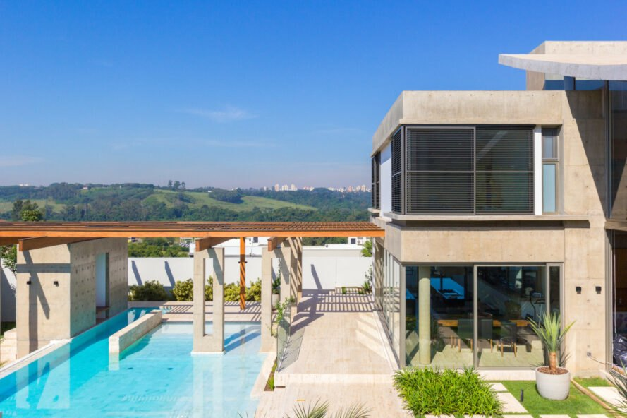concrete home with swimming pool