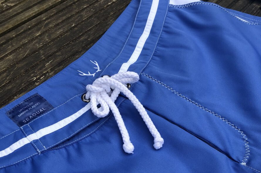 blue swim shorts placed on table