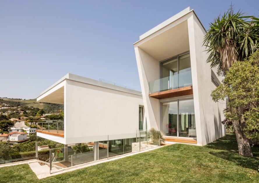 large white home with wood decks