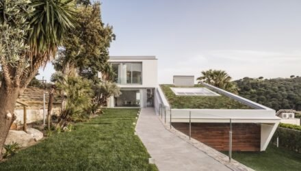 Green-roofed luxury home blends historic Spanish influences with contemporary design...