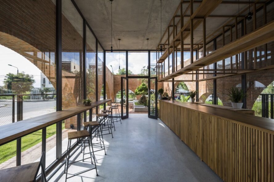 coffee shop with glass and brick walls