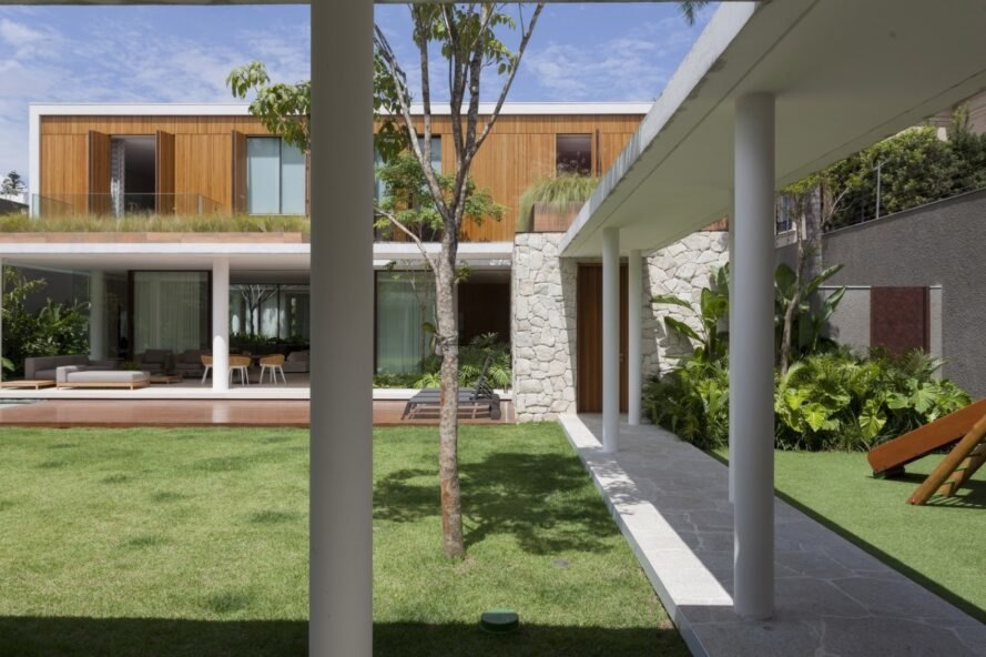 two-story white and wood home with central courtyard