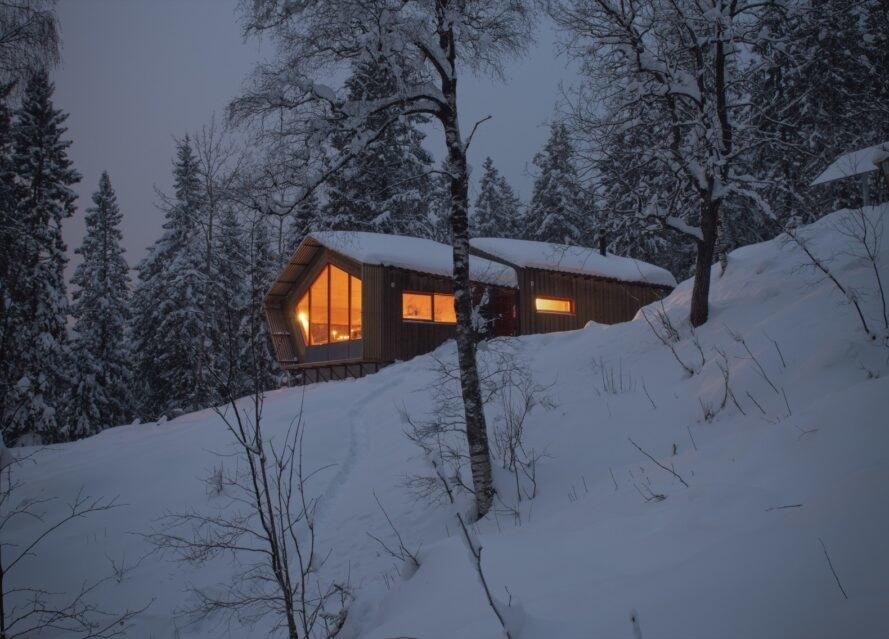wood cabin covered in snow