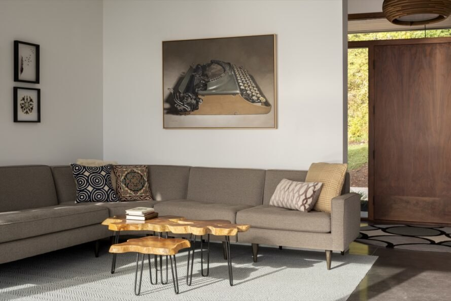 tan sofa with art canvas on wall
