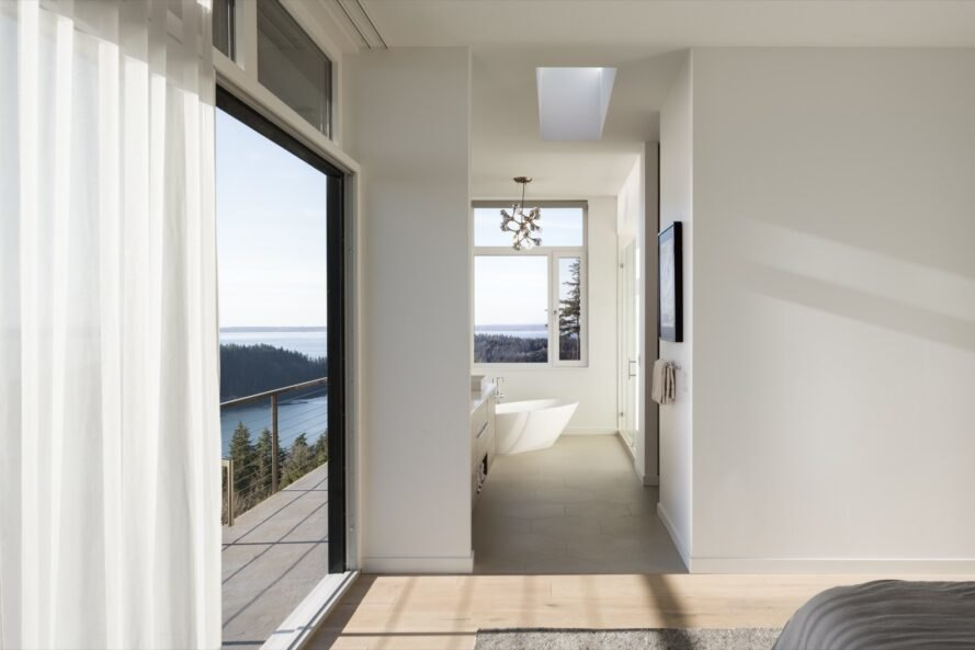 bedroom with large glass wall