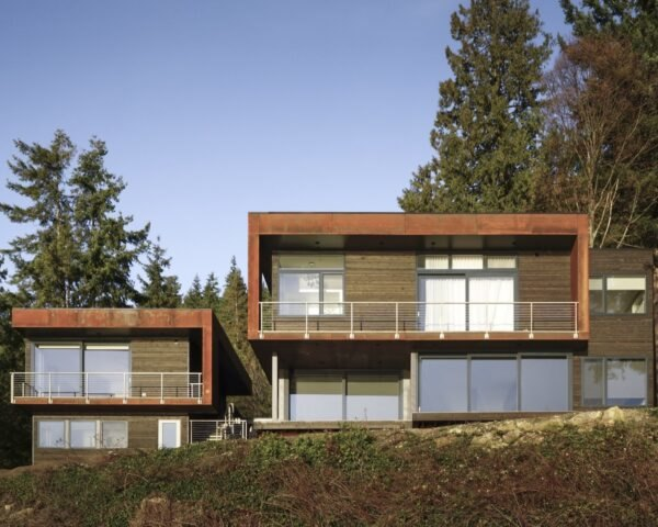 metal and wood home on hill facing Puget Sound