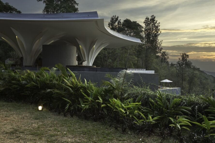 Modern luxury resort blends into the lush coffee hills of India