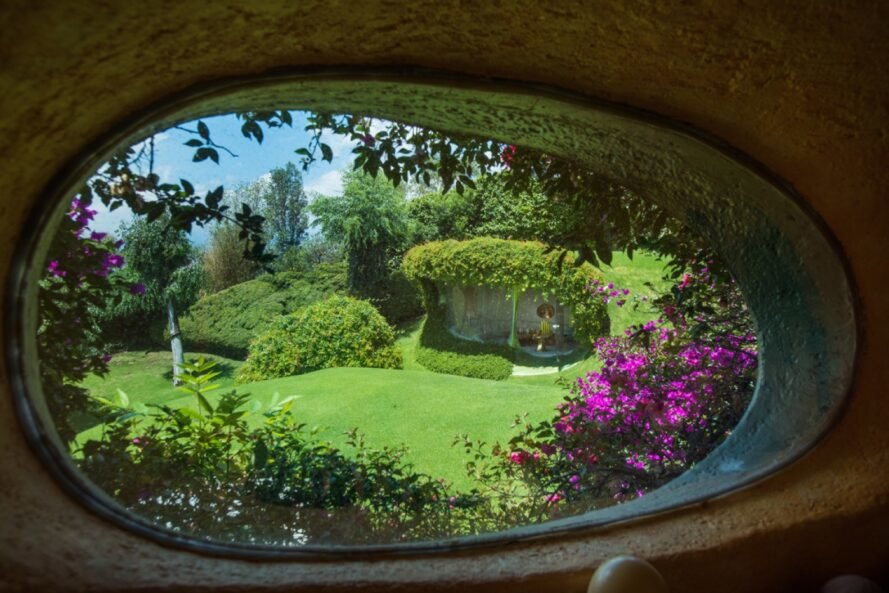 view of gardens from indoor, rounded window