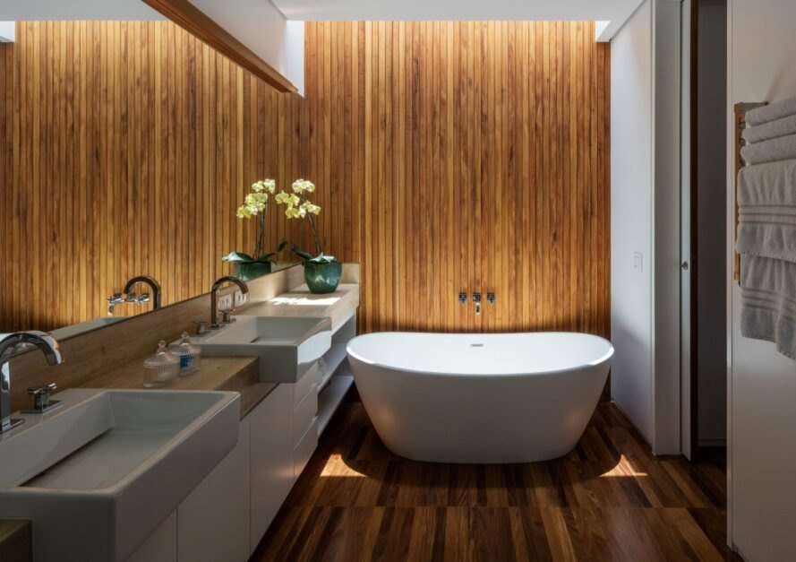 bathroom with bathtub and wooden walls