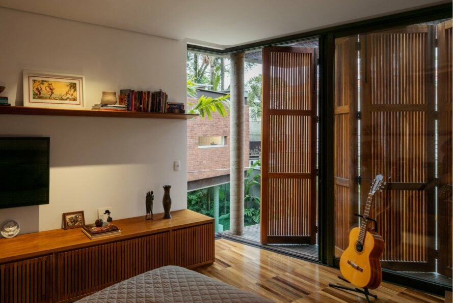 bedroom with wood cabinets and wood shutters over windows