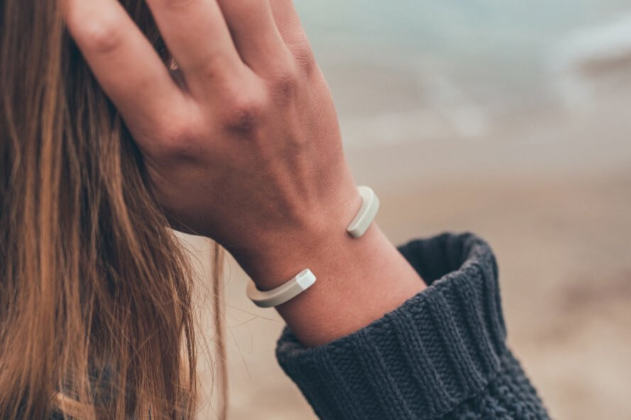 person wearing light colored bracelet