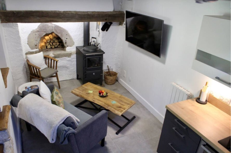 interior of tiny home with built-in chimney