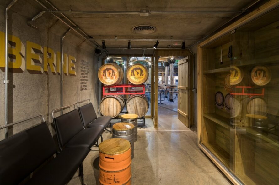 interior of brewery with barrels as tables