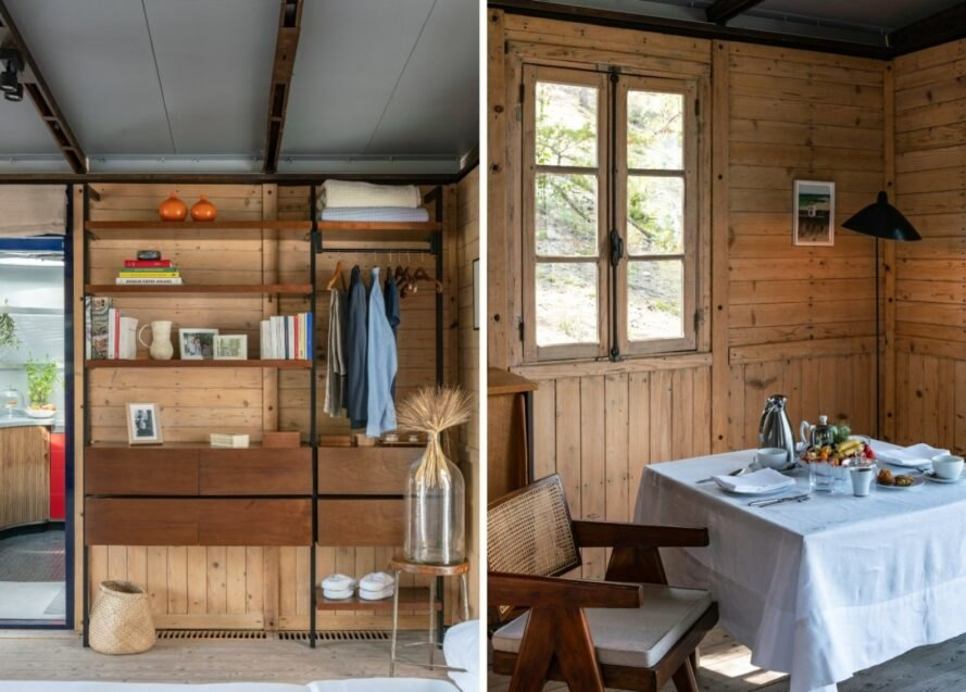 wood-lined cabin interior with basic furnishings