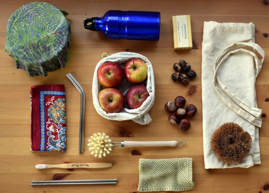 zero-waste products flat-lay on wood table