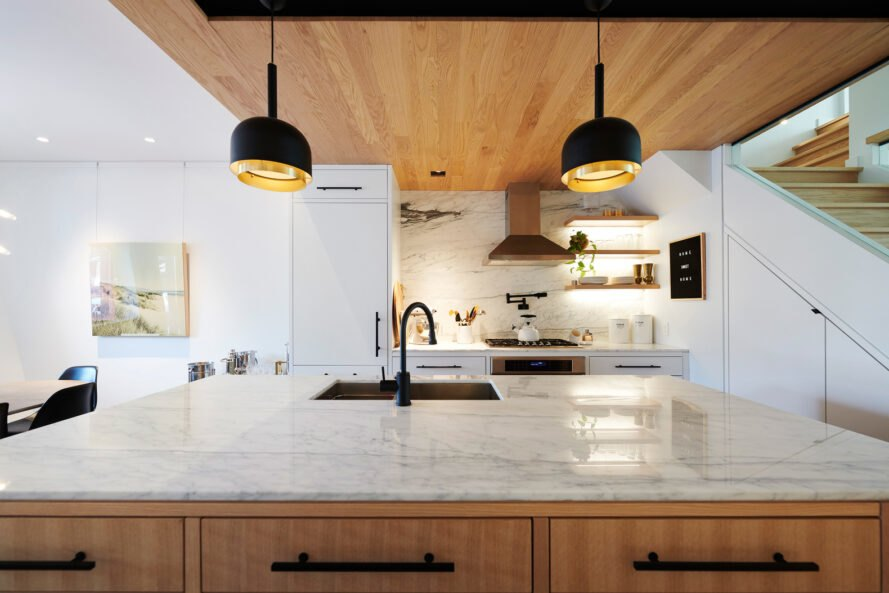 kitchen with wood cabinets and marble countertops
