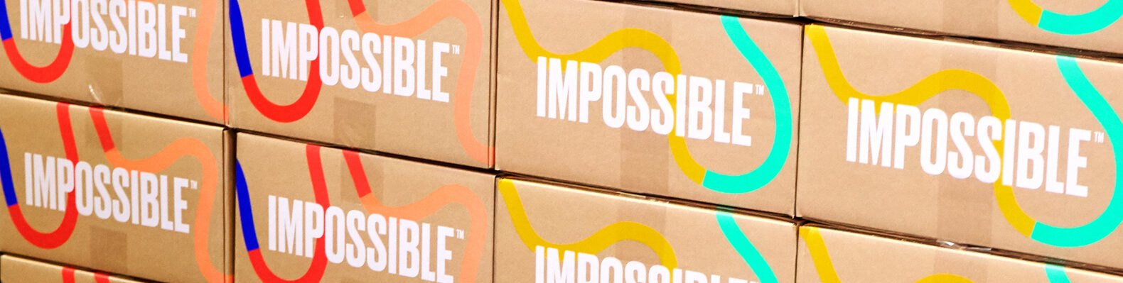 boxes with Impossible logo