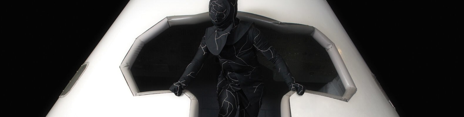person wearing black suit