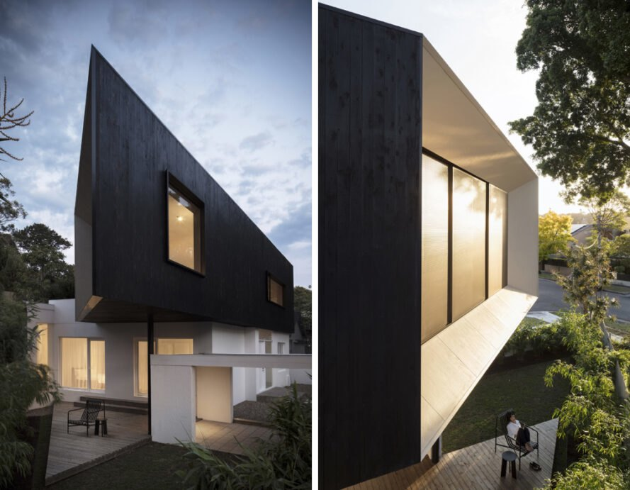 white house with black geometric upper floor extension