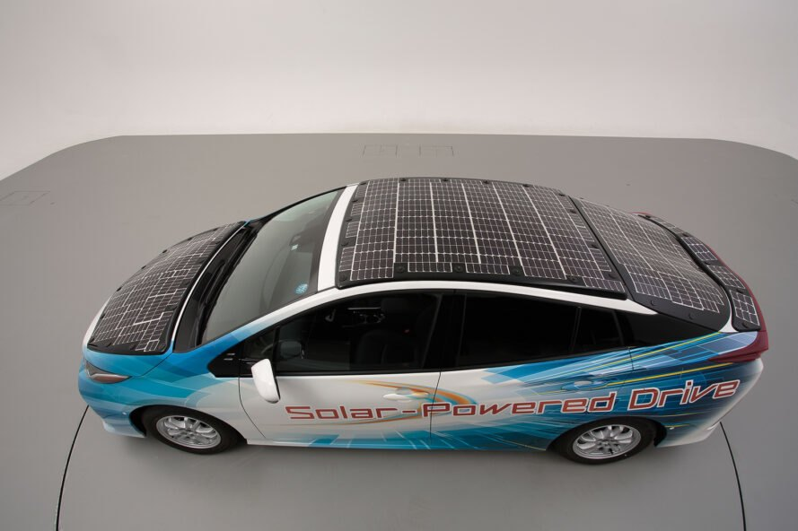 aerial view of car with solar panels on hood, top of car and trunk