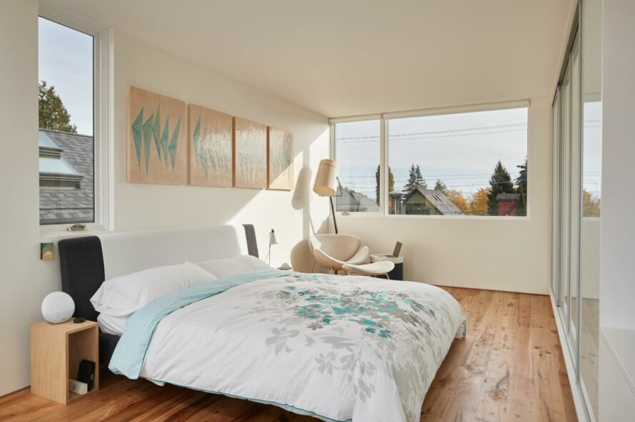 all white bedroom with large window