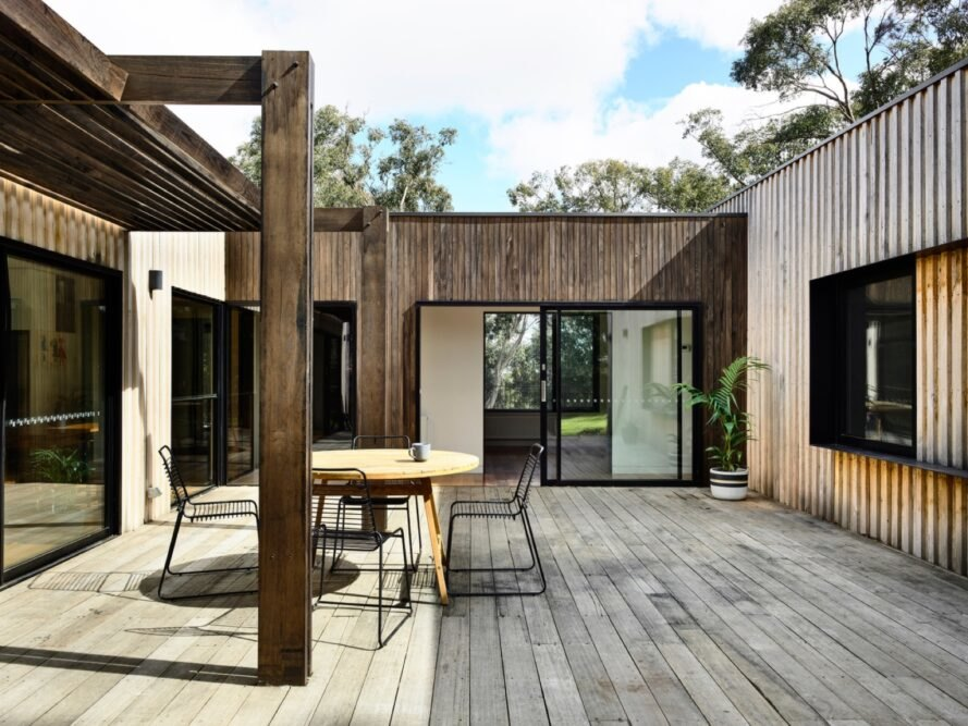 light timber courtyard with small table and chairs