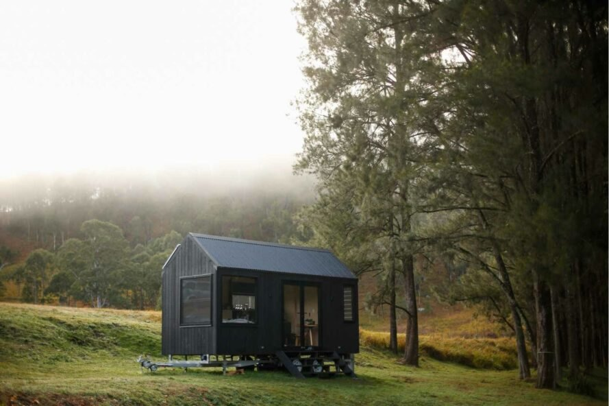 tiny black cabin with pitched roof