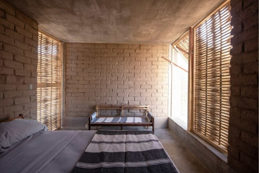interior bedroom with adobe walls