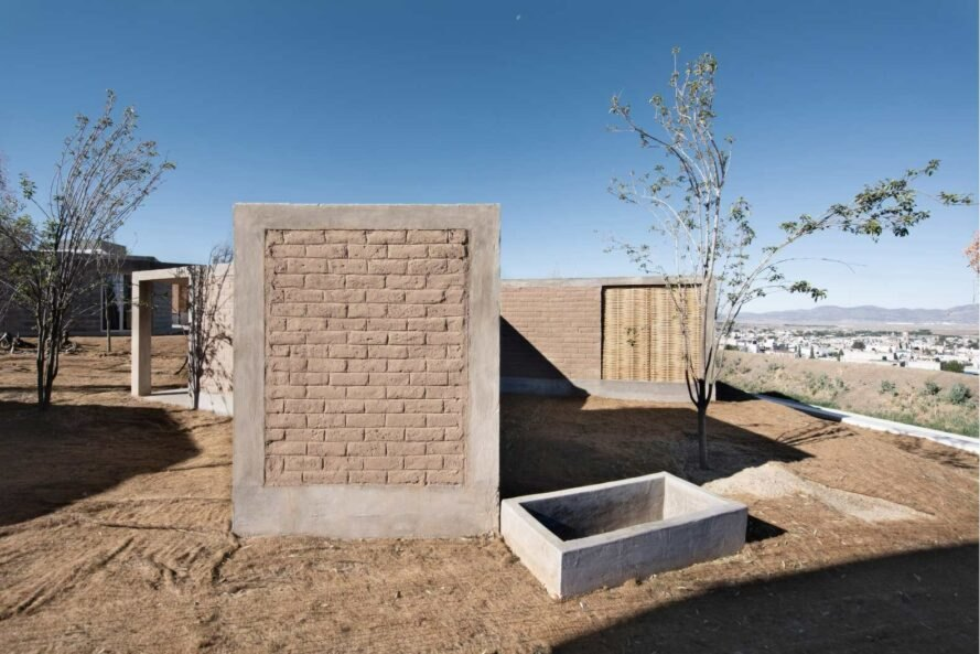 concrete-framed modules with adobe walls