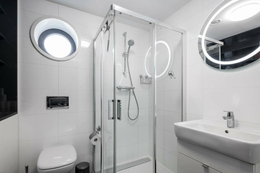 white bathroom with standing glass shower