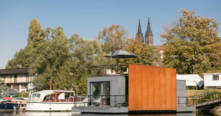 Prefab houseboat in Prague features a spacious rooftop lounge