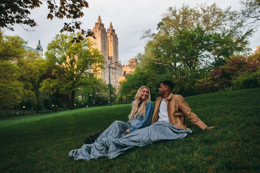 a couple uses a blanket at a NYC park