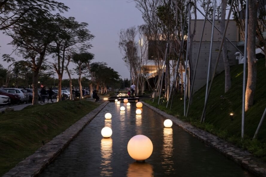 white orb lamps in a long pool