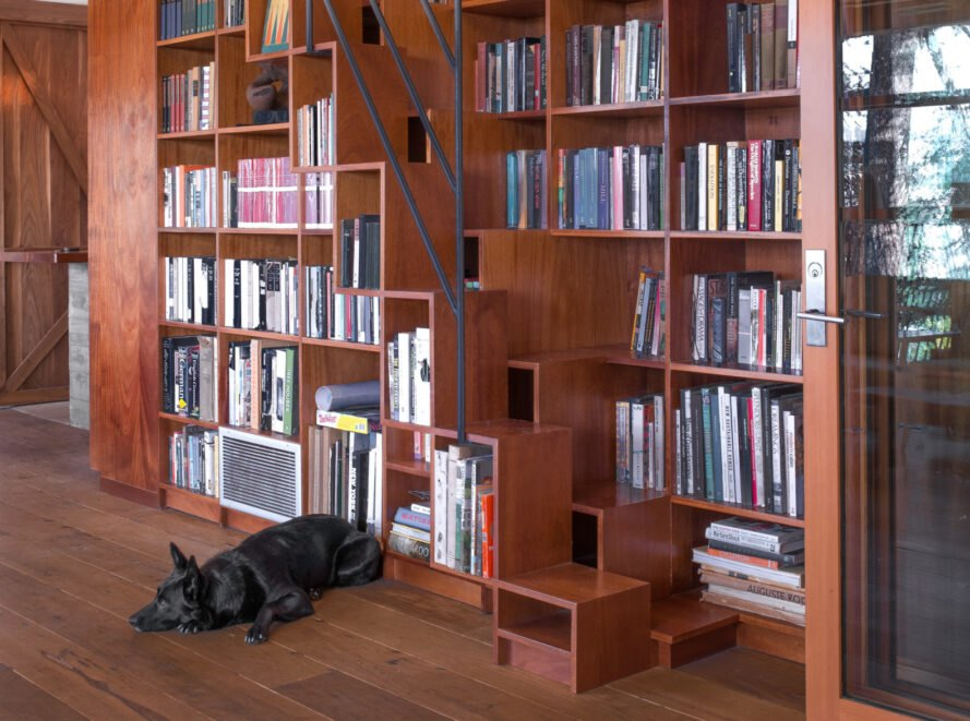 wall library with steps leading up to reading nook