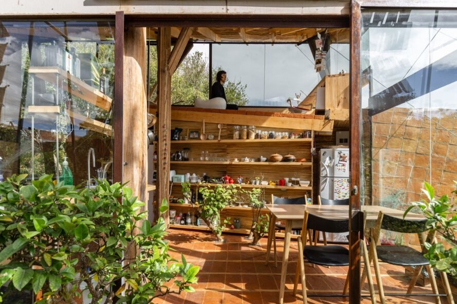 A playful home built of recycled materials takes in sunrise