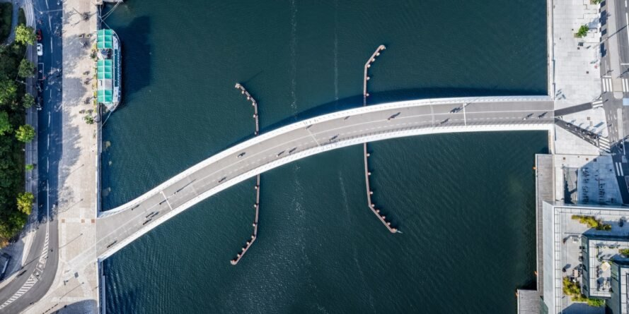 aerial view of curved bridge over water