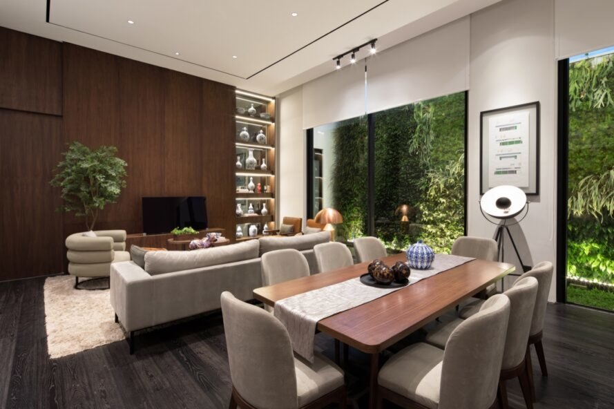 open-plan living and dining area with wood dining table and gray sofa