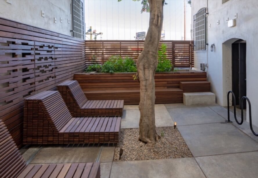 courtyard with tree and wood benches