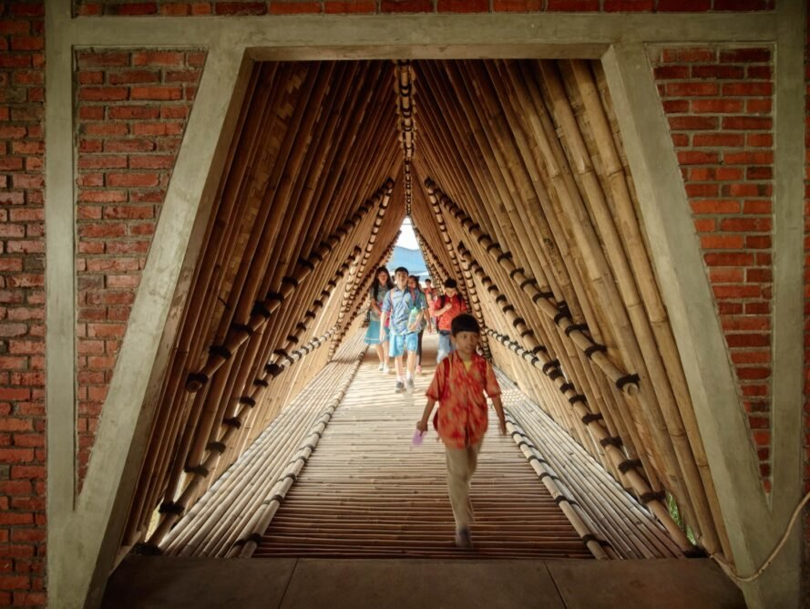 children walking through covered walkway